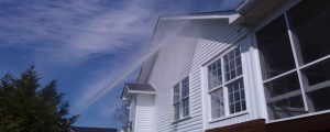pressure washing from distance siding of the house