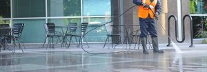 men cleaning commercial Houston pressure washing
